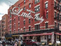 New York, NY / United States-July 5, 2016- Welcome to Little Italy Sign at Mulberry Street. The Welcome to Little Italy sign hanging over Mulberry Street stock photo