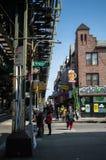 New York, NY  USA - April 2016: colourful  shops on the streets of Brighton Beach near the metal transport bridge.  Stock Photo