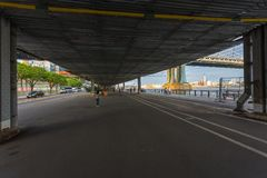 Street and pedestrian area under the overpass near the Manhattan Bridge in Down Manhattan. stock image