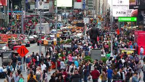 New York, NY, USA. Close up of thousands of people walking in Time Square, Broadway and on the seventh Avenue. Aerial view