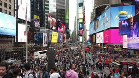 New York, NY, USA. Close up of thousands of people walking in Time Square, Broadway and on the seventh Avenue. Aerial view stock video footage