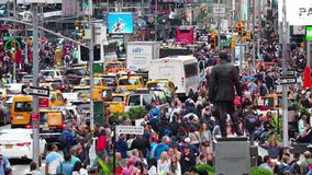 New York, NY, USA. Close up of thousands of people walking in Time Square, Broadway and on the seventh Avenue. Heavy traffic on the 7th. Ave. Aerial view stock video
