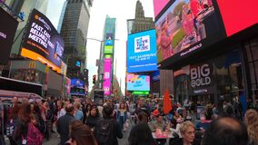 New York, NY, USA. Crowded Time Square and billboards on buildings facades at late afternoon or early evening
