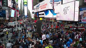 New York, NY, USA. Crowded Time Square and billboards on buildings facades at late afternoon or early evening. Thousands of people