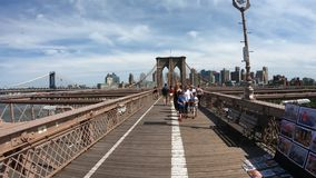 New York, NY, USA. Gopro 4K Hyper lapse walking along the Brooklyn bridge in a wonderful summer day. Walking from Manhattan to Brooklyn stock video footage