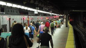 New York, NY, USA. Grand Central Station. Many people walking to the departing train