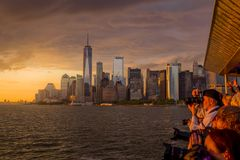 View of NYC skyline at sunset. New York, NY USA - JUNE 4, 2018. Photographers taking spectacular sunset photos from cruise ship with lower Manhattan in Stock Photography