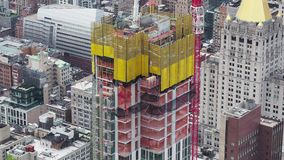 New York, NY, USA. New skyscrapers under construction. Construction site with cranes, elevators and scaffolding. Manhattan and Brooklyn stock footage