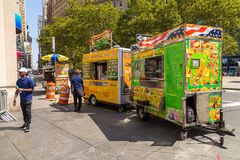 Street food colorful vendor cart in State Street, Downtown Manhattan. stock images