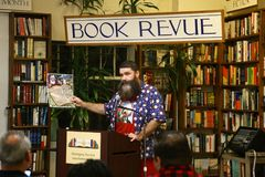 Mick Foley. NEW YORK-OCT 19: Mick Foley signs copies of his book, `Saint Mick: My Journey From Hardcore Legend to Santa`s Jolly Elf` at Book Revue on October 19 Stock Images