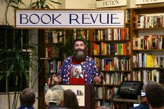 Mick Foley. NEW YORK-OCT 19: Mick Foley signs copies of his book, `Saint Mick: My Journey From Hardcore Legend to Santa`s Jolly Elf` at Book Revue on October 19 Stock Photo