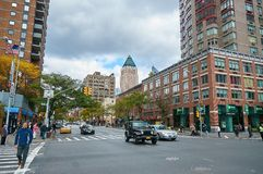 NEW YORK CITY, MANHATTAN, OCT,25, 2013: View on NYC street and road with cars, people with buildings and shops in the background. royalty free stock photos