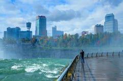 NEW YORK, OCT, 24, 2013: View on Niagara fall waterfall of Buffalo city a man and Toronto city Canada. Green blue water. USA Niaga stock photo