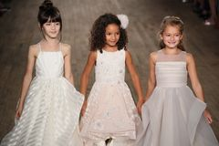 Kid models walk the runway for Blush by Hayley Paige  Bridal show Fall/Winter 2018 Collection. NEW YORK - OCTOBER 6: Kid models walk the runway for Blush by Royalty Free Stock Image