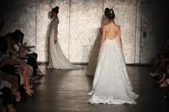 A Model walks the runway for Inbal Dror Bridal show Fall/Winter 2018 Collection. NEW YORK - OCTOBER 5: A model walks the runway for Inbal Dror Bridal show Fall/ royalty free stock photography