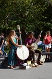 Two street musicians playing for tourists in Washington Square P Royalty Free Stock Images