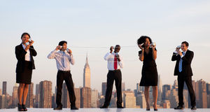 New York Office Workers via cup Communication Royalty Free Stock Photo