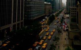 New York, Park Avenue, carrozze gialle Fotografia Stock