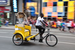 New York Pedicab. A pedicab driver driving a pedicab at Times Square in New Yok, USA Royalty Free Stock Photos