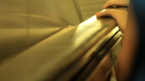New York people with hands on escalator handrail, travelling on escalator stock footage