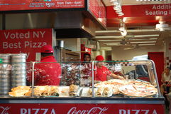 New York Pizza. An open-front store offers pizza and coca-cola for sale on a New York street Royalty Free Stock Photography