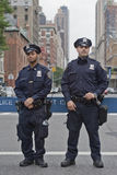 Two New York police officers. Two offers of the New York Police Department with a street in the background, U.S.A Royalty Free Stock Images