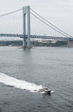 New York Police Boat Cruising Under Verrazano Bridge Stock Images