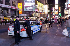 New York, Police car and policemen in the Times Square. New York City, USA - OCT 9, 2014 : Police car and policemen in the Times Square. Times Square is major Royalty Free Stock Photos