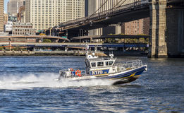 New York Police Department controls with a speed boat the river Royalty Free Stock Photo