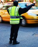 New York Police directing traffic. NYPD officer directing taxis on a busy street in Times Square Stock Photo