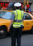 New York Police directing traffic. An officer of the New York Police Department (NYPD) directing traffic on a busy street Stock Photography