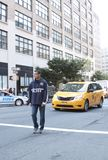 A New York police officer directing traffic downtown. In manhattan Stock Photos