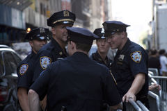 New York police officers talking among them on the street. New York police officers talking among them stock images