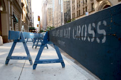 New York police picket fence. In preparation for a parade, the NYC police barricade the sidewalks with infamous blue fencing that reads, Police Line Do Not Cross Stock Photos