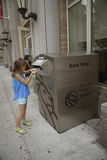 New York Public Library book drop. Child dropping off her library books at a New York Public Library book drop Royalty Free Stock Images