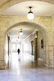 New York Public Library Hallway. A silhouetted man walks down a long, bright hallway at the New York Public Library Royalty Free Stock Image