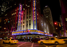 New York , Radio city. New York city , Radio City music hall , speeding taxi flying by royalty free stock images