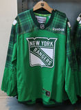 New York Rangers St. Patric`s Day special edition jersey on display at NHL store Stock Photo