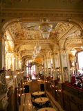 New York restaurant interior in Budapest. Marble columns and opulent bronze decoration. Ceiling is decorated with paintings and sculptures.  A luxurious place Royalty Free Stock Images