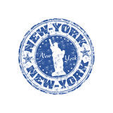 New York rubber stamp. Blue grunge rubber stamp with the Statue of Liberty and the name of New York written inside the stamp Stock Image