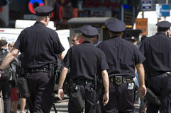 New York's Finest. Four New York City cops patrolling times square Stock Photo