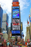 New York's Times Square. New York, NY - June 24, 2014: New York City's Times Square, the junction of Broadway and 7th Avenue, is now one of the busiest stock image