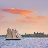 New York sailboat sunset and Ellis Island Stock Images