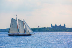 New York sailboat sunset and Ellis Island Royalty Free Stock Images
