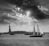 New York sailboat sunset and Statue of Liberty Stock Photos