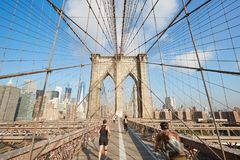 Brooklyn Bridge in a sunny morning with people running in New York Stock Photos