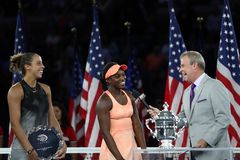 Finalist Madison Keys L  and US Open 2017 champion Sloane Stephens during trophy presentation after women`s final match Stock Photos