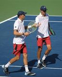 Grand Slam champions Mike and Bob Bryan of United states in action during US Open 2017 round 3 men`s doubles match. NEW YORK -SEPTEMBER 4, 2017: Grand Slam Royalty Free Stock Photography