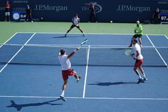 Grand Slam champions Mike and Bob Bryan of United states in action during US Open 2017 round 3 men`s doubles match. NEW YORK -SEPTEMBER 4, 2017: Grand Slam Stock Photos