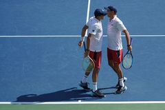 Grand Slam champions Mike and Bob Bryan of United states in action during US Open 2017 round 3 men`s doubles match. NEW YORK -SEPTEMBER 4, 2017: Grand Slam Royalty Free Stock Image